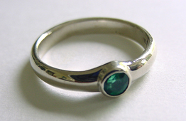custom engagement ring with 4mm emerald set in white gold