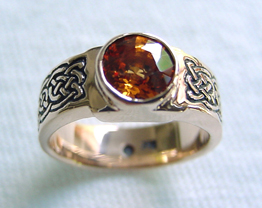 custom engagement ring with 6mm spessartine garnet in yellow gold